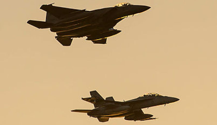 A-mixed-formation-of-a-RSAF-F-15-1SQN-FA-18F-Super-Hornet-fly-a-public-display-over-Mindil-Beach-Darwin.jpg