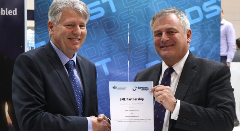 Chief-Defence-Scientist-Dr-Alex-Zelinsky-and-Mr-Ben-Norris-CEO-of-Daronmont-Technologies-sign-the-collaborative-agreement-at-LAND-FORCES-22018-Source-Daronmont-Technologies.jpg