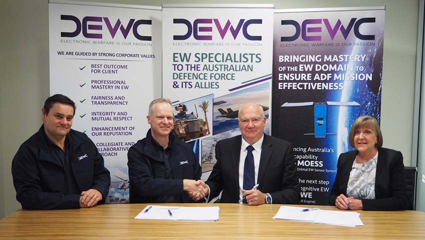 DEWC_merger_signing.jpg