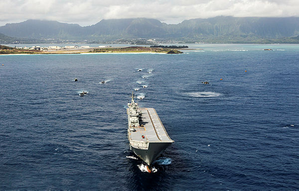 hmas adelaide waits for us marine amphibious assault vehicles to embark during rimpac