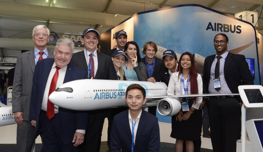 rmit vice chancellor and president  martin bean cbe with students from the three teams and staff at the airbus exhibition