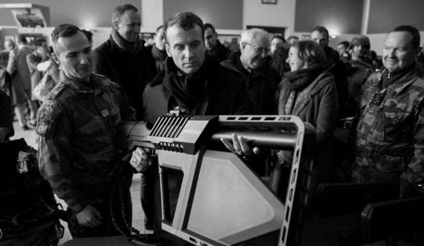 President-Macron-holding-a-DroneGun.jpg